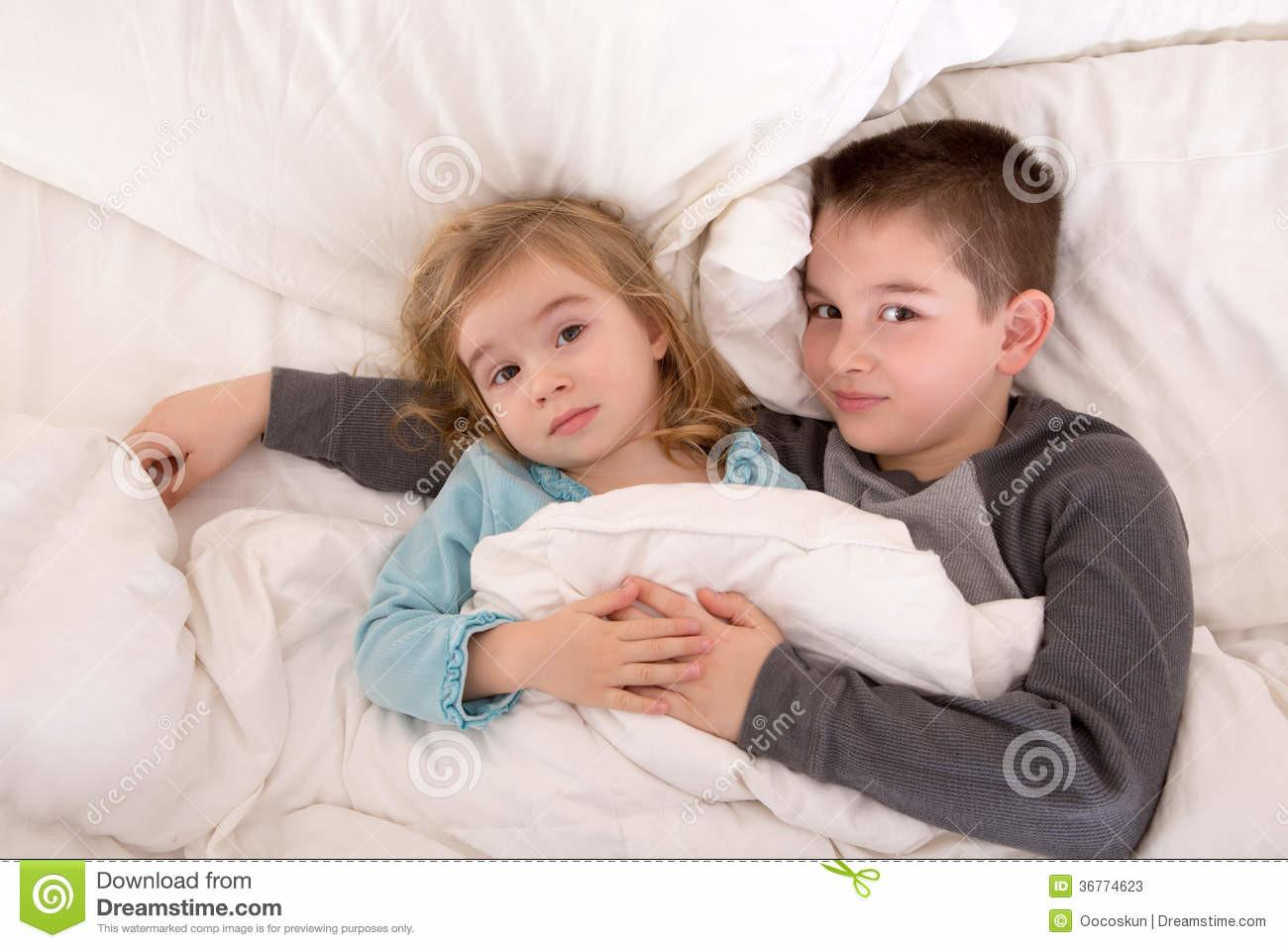 Affectionate Young Brother Sister Lying Bed Stock