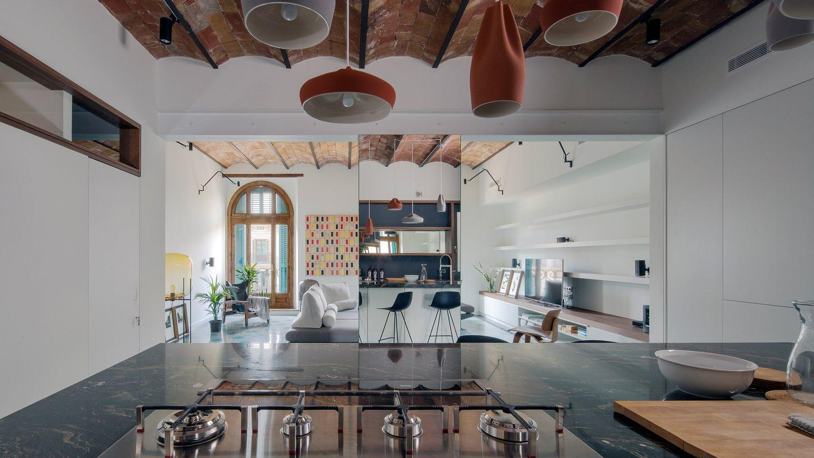 Apartment Renovation Uses Mirrors Amplify Space