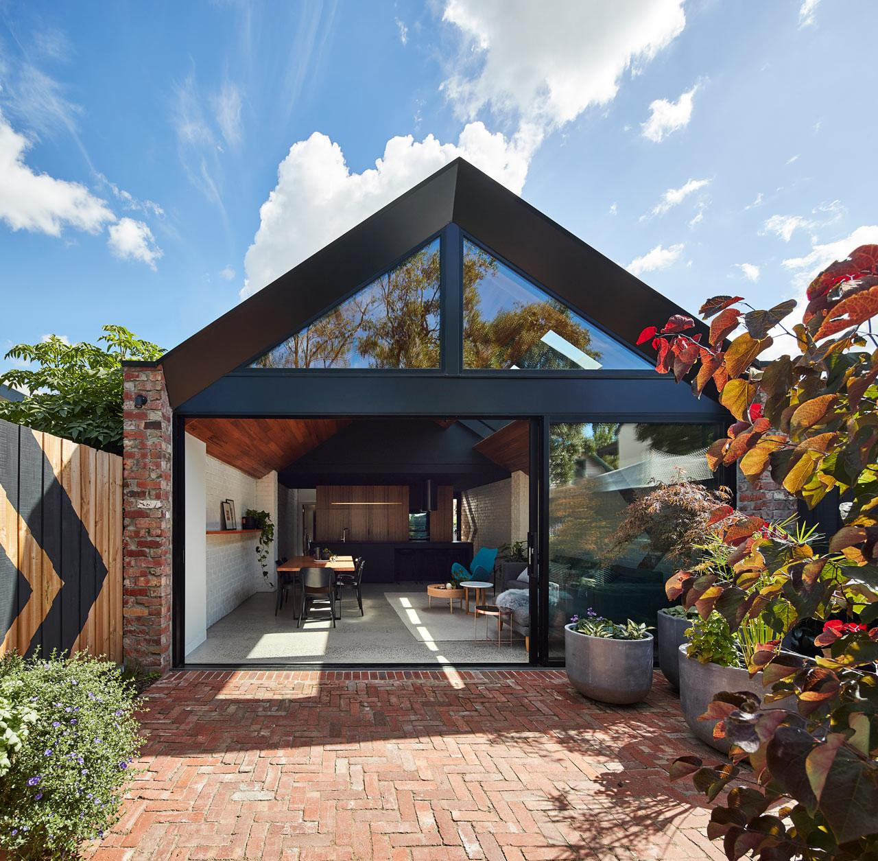 Architecture Transforms Cottage Into Two Story