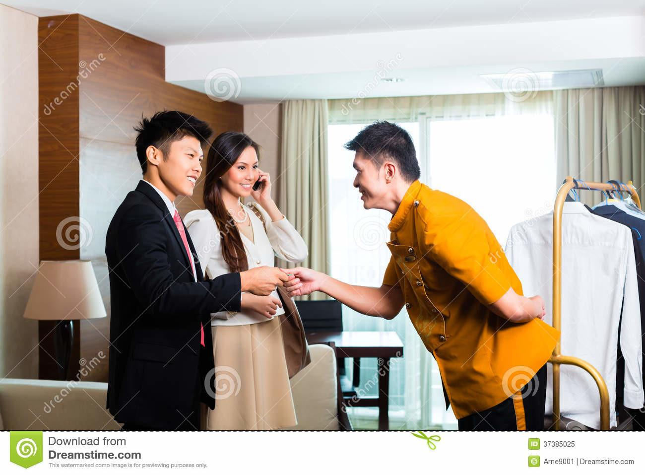 Asian Chinese Bell Boy Porter Receiving Tip Royalty