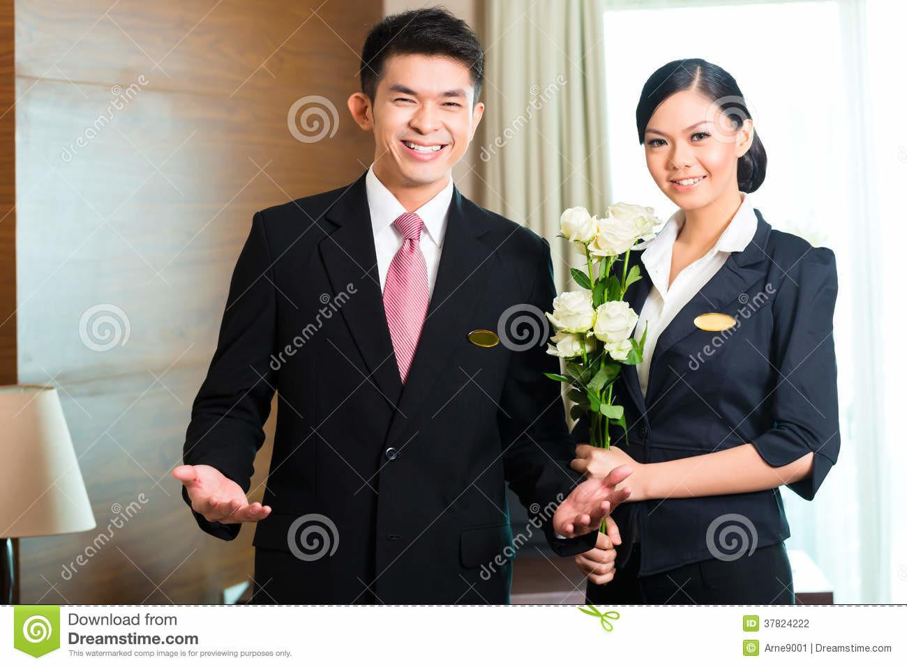 Asian Chinese Hotel Manager Welcoming Vip Guests Stock