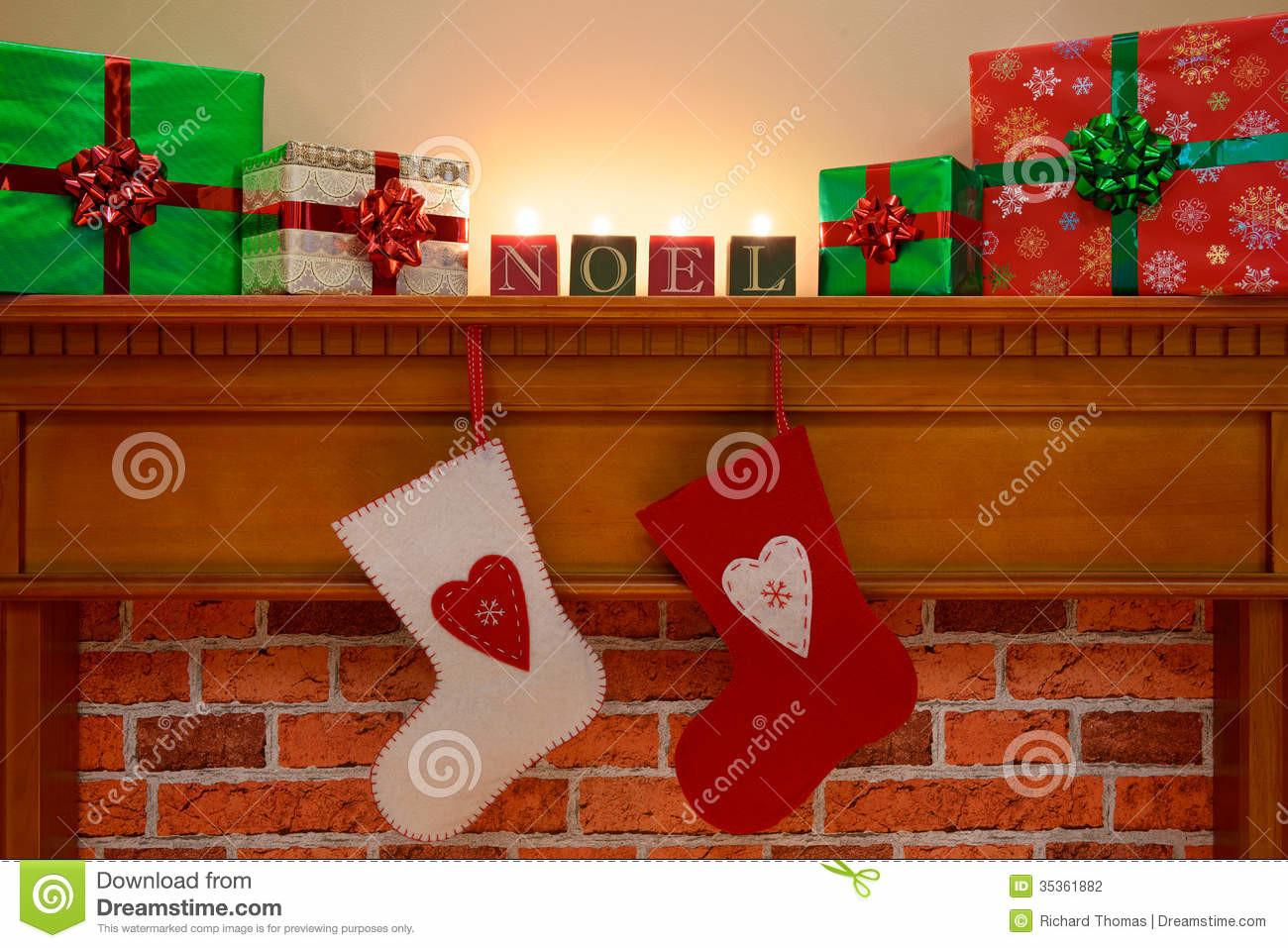 Christmas Stockings Under Mantlepiece Stock