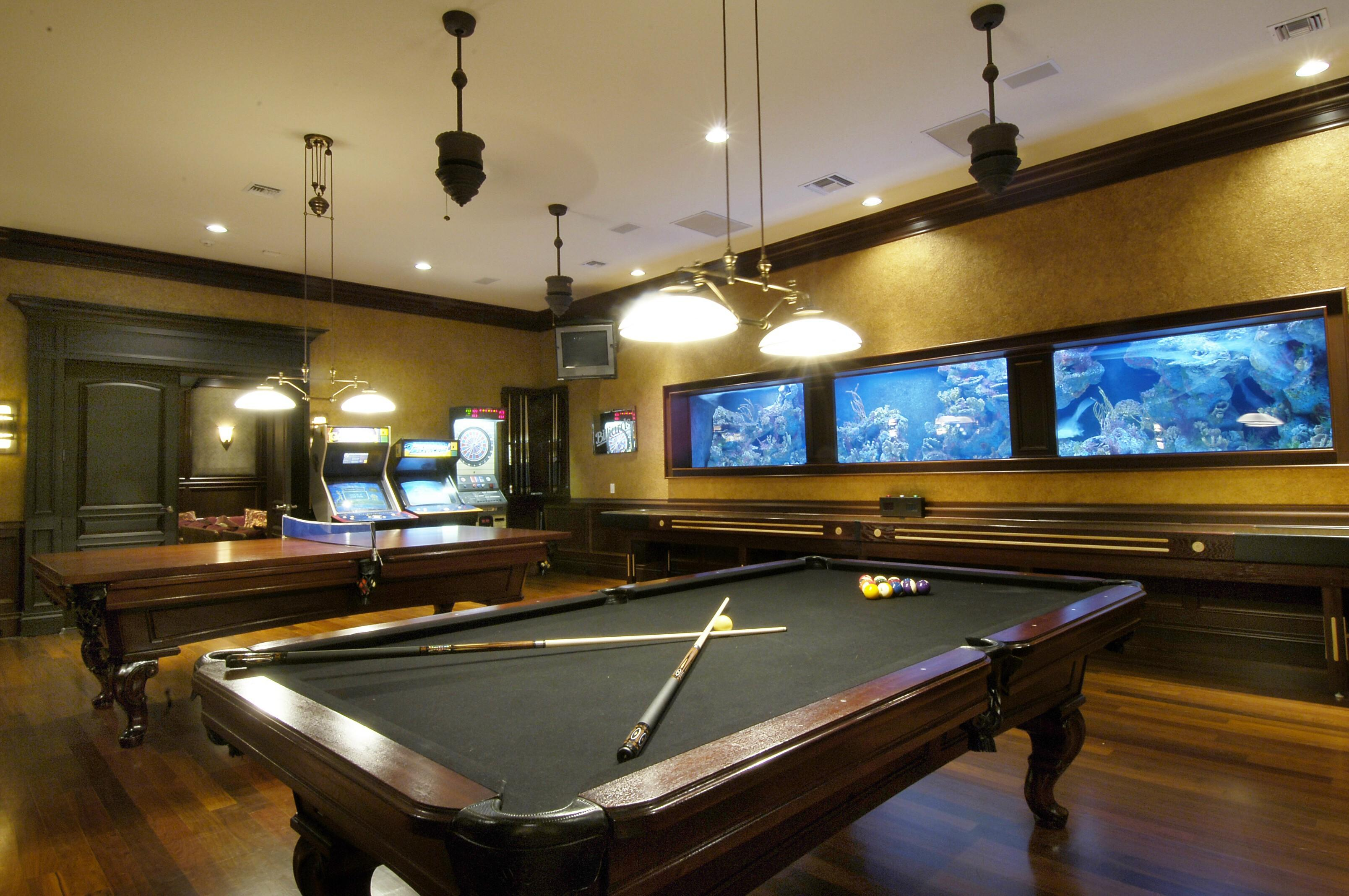 Classic Pool Table Under Ceiling Hanging Lights Wall