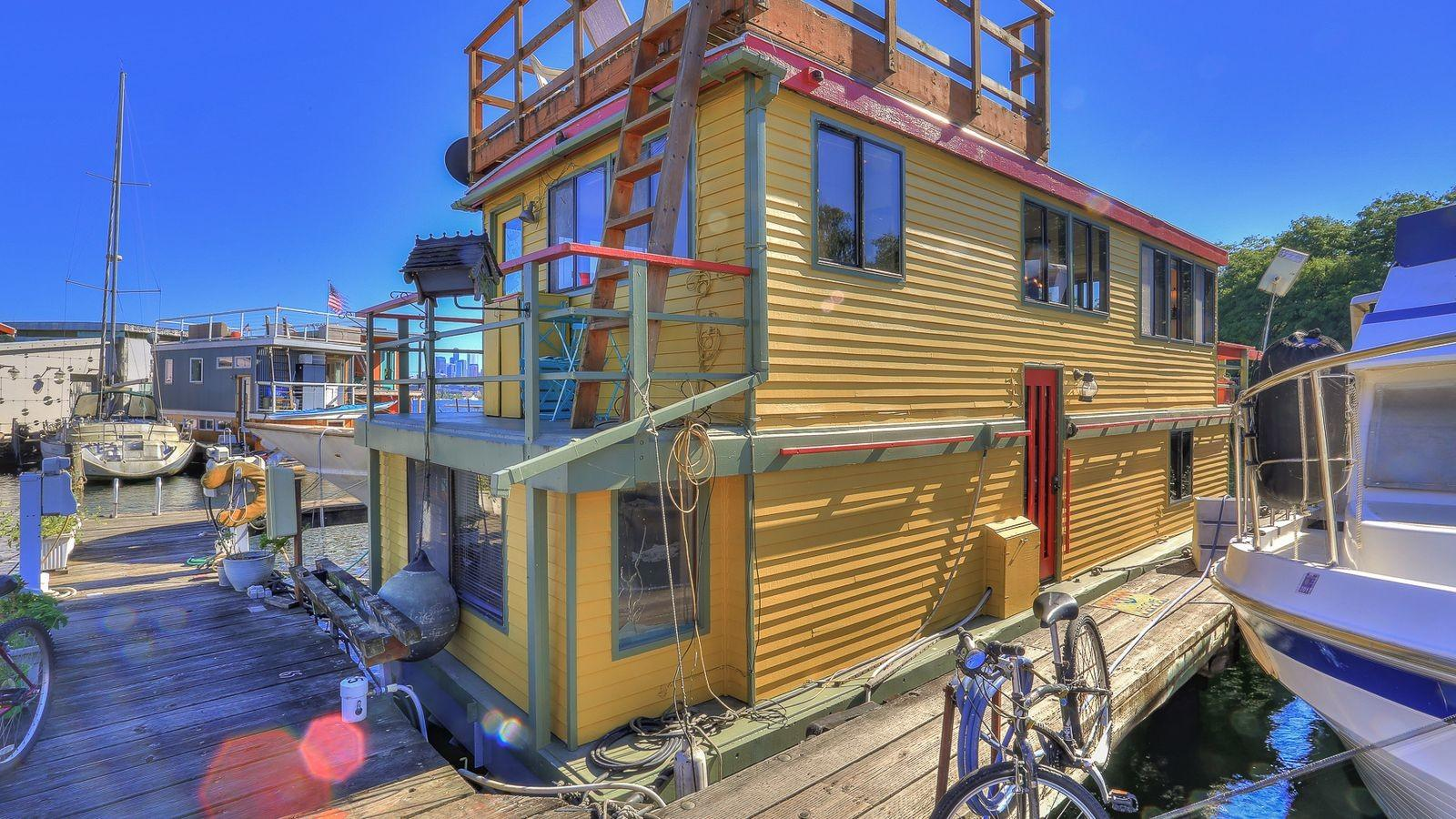Colorful Lake Union House Barge Space Needle Views
