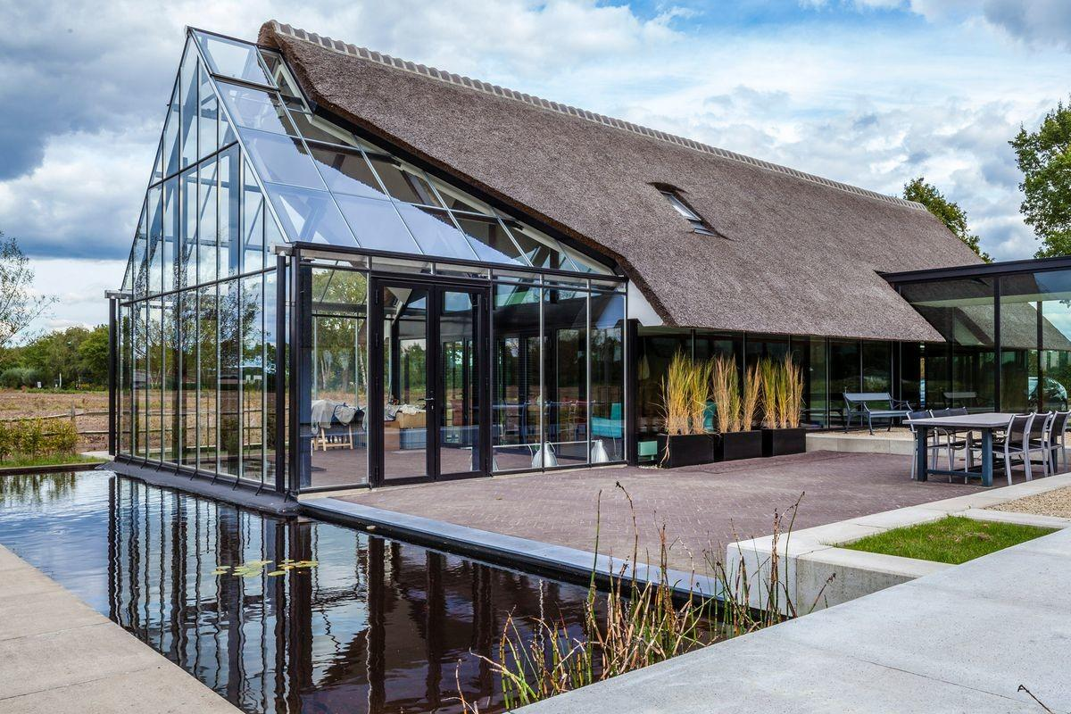 Cottage Meets Greenhouse Modern Thatched Home Curbed