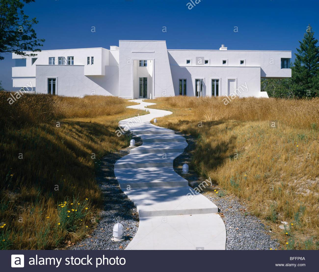 Curved Stone Path Through Grasses Modern White House