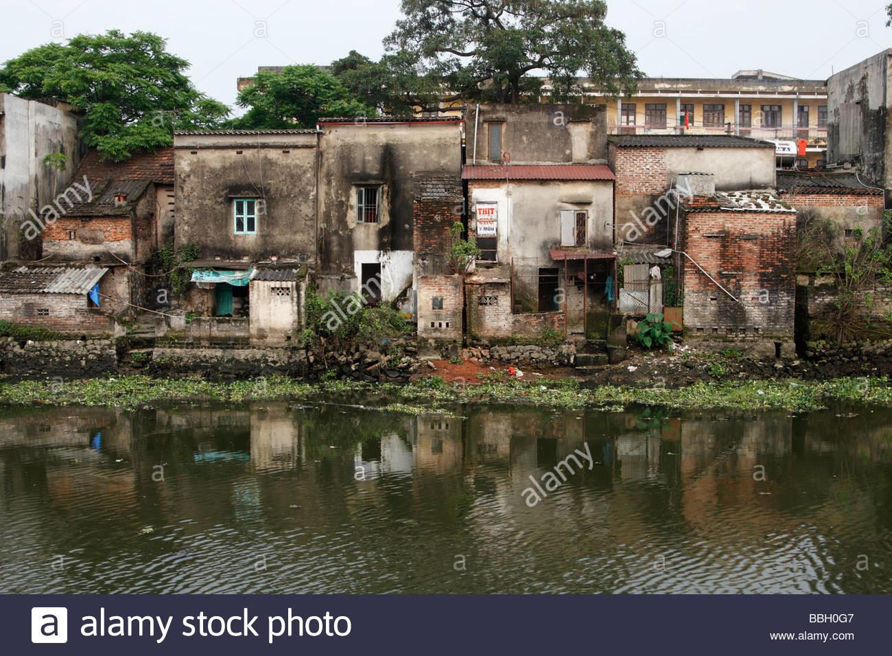 Derelict Old Houses Along City Canal Poor Urban Slum