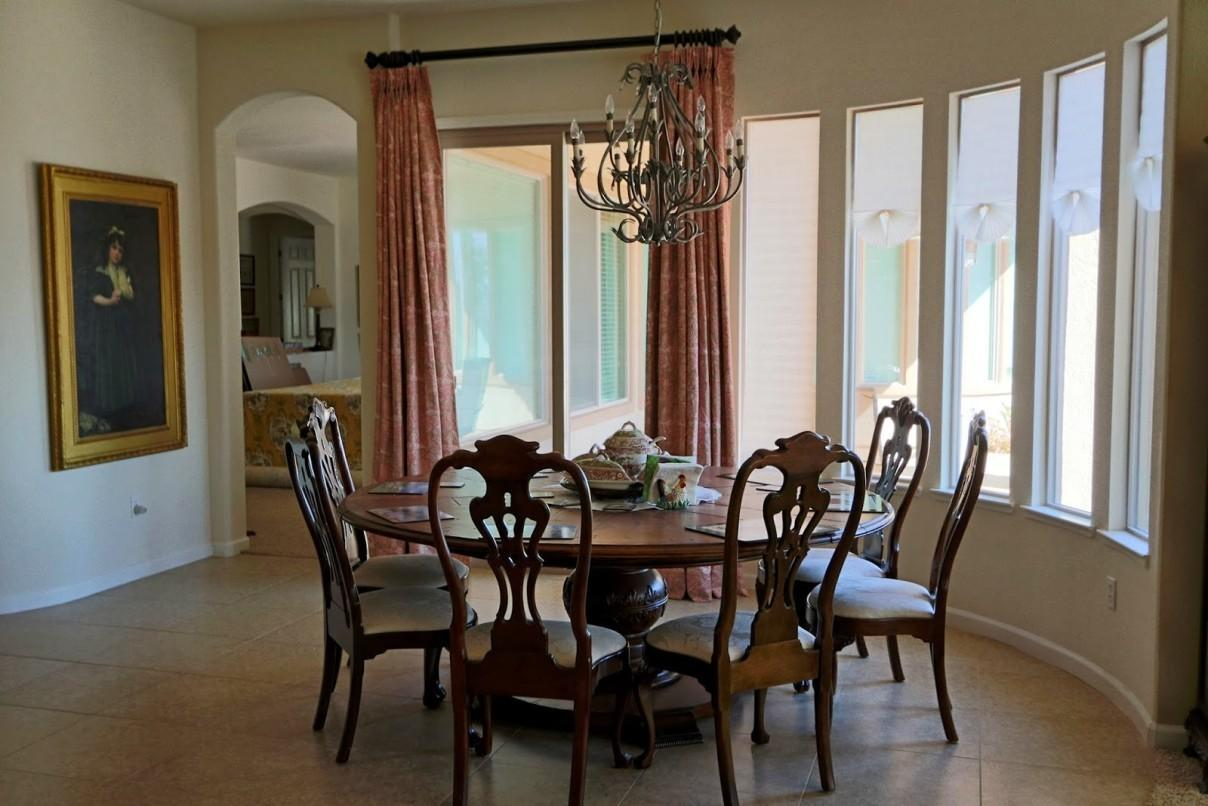 Dining Room Classic Chandelier Above Colonial