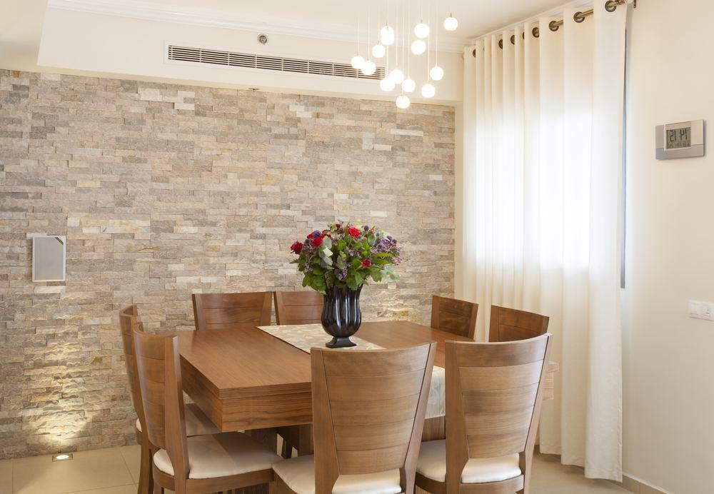Dining Room Stone Accent Wall Yellow Chairs Square
