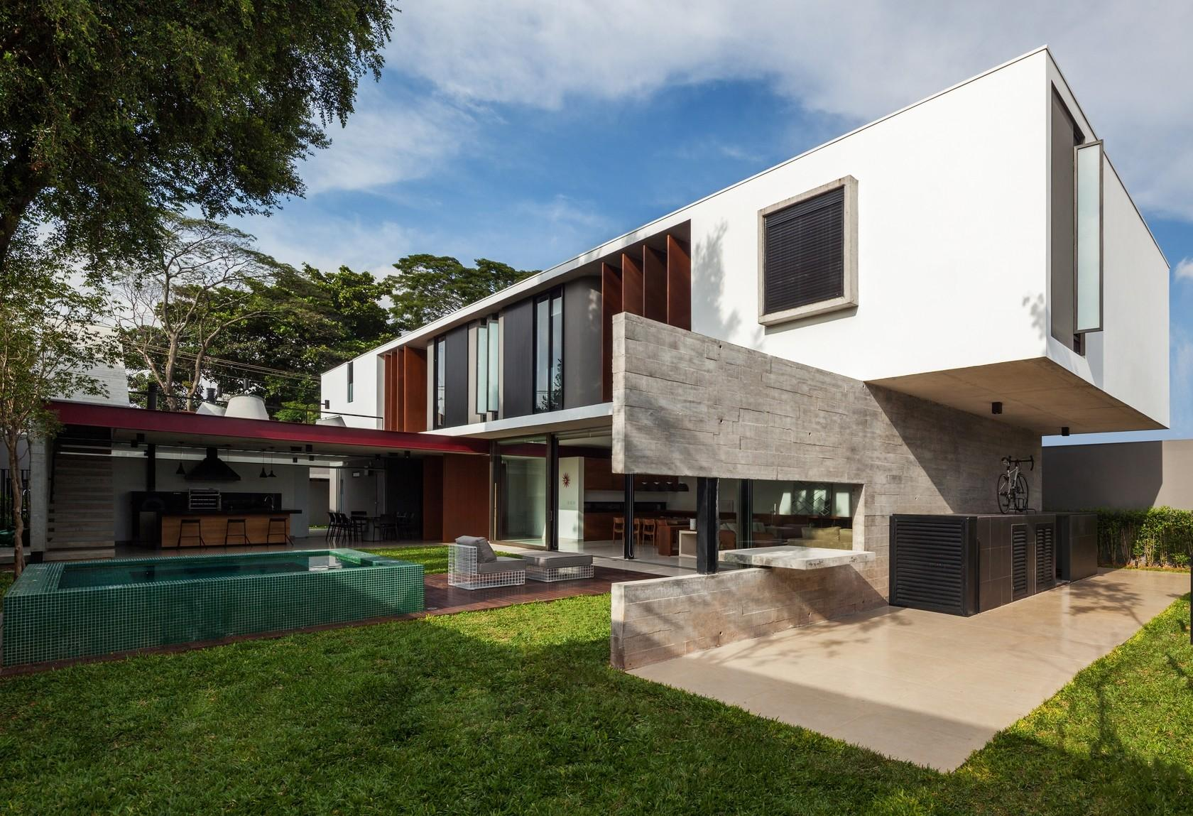 Dual Direction Concrete Home Surrounds Poolside Courtyard