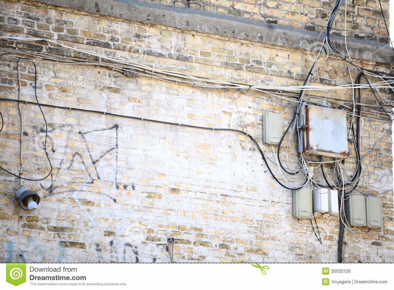 Electric Controller Box Tangle Cables Brick Wall