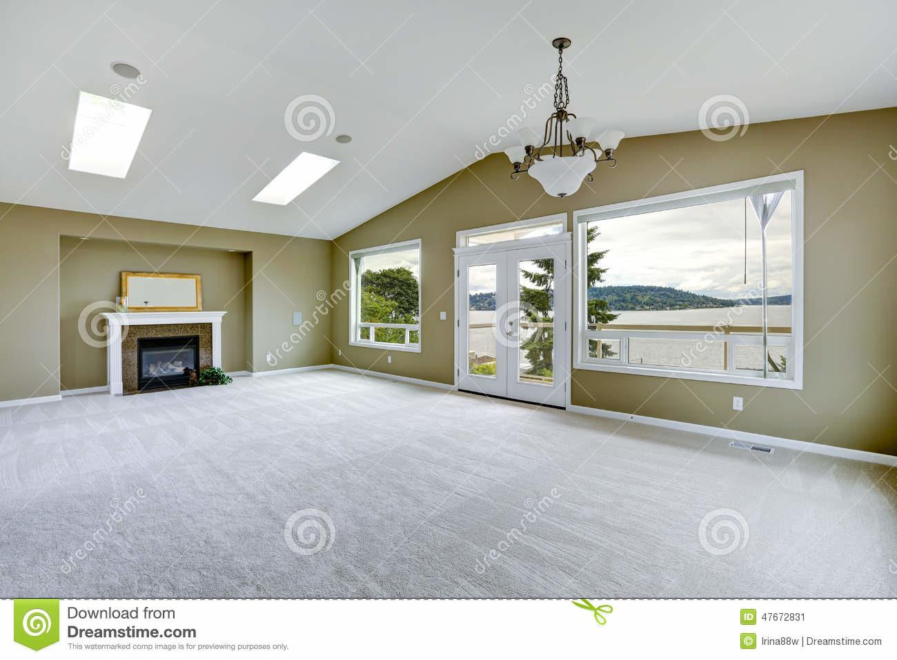 Empty Spacious Living Room Walkout Deck Fireplace