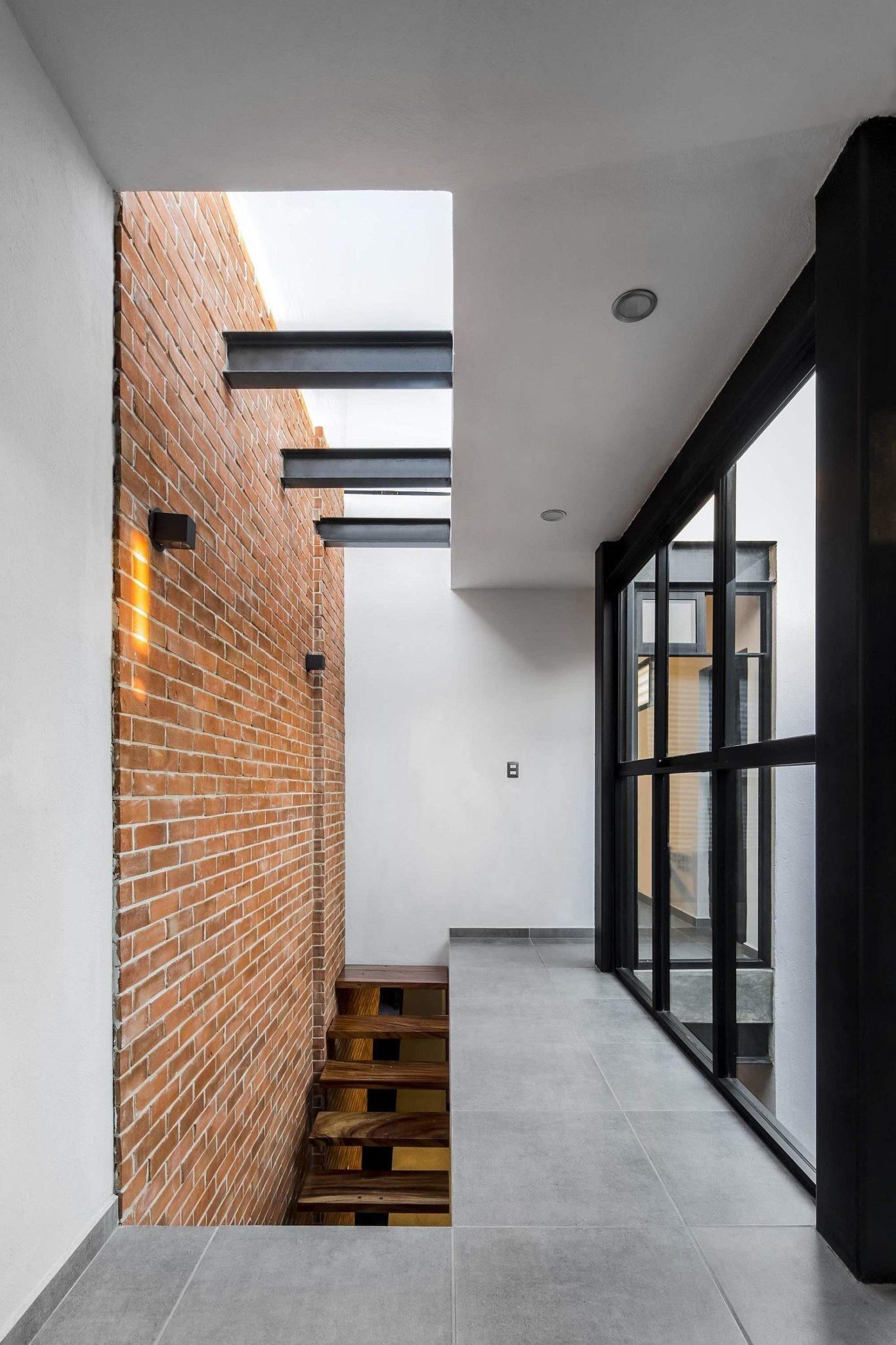 Exposed Brick Walls Steal Show Modern