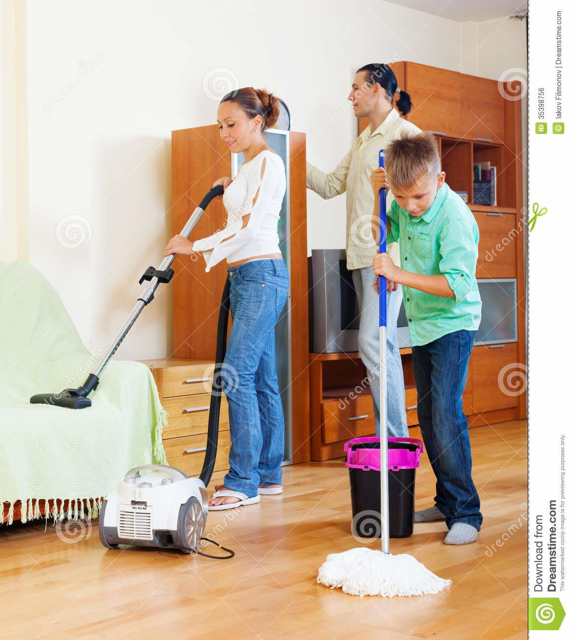 Family Teenage Boy Cleaning Living Room Stock