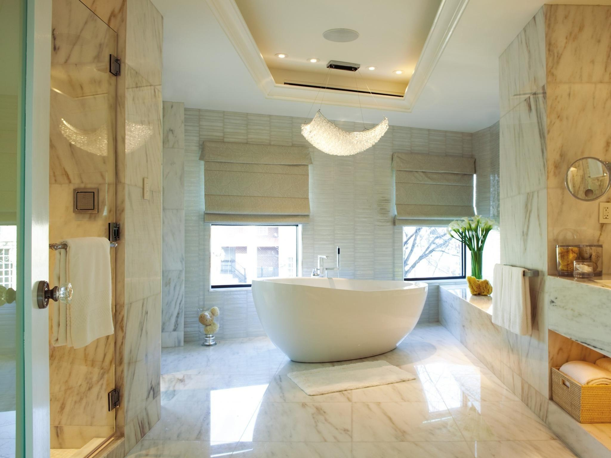 Fancy Chandelier Above White Freestanding Tub Combined