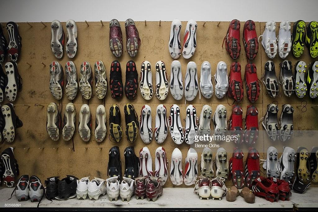Football Boots Hanging Wall Stock Getty