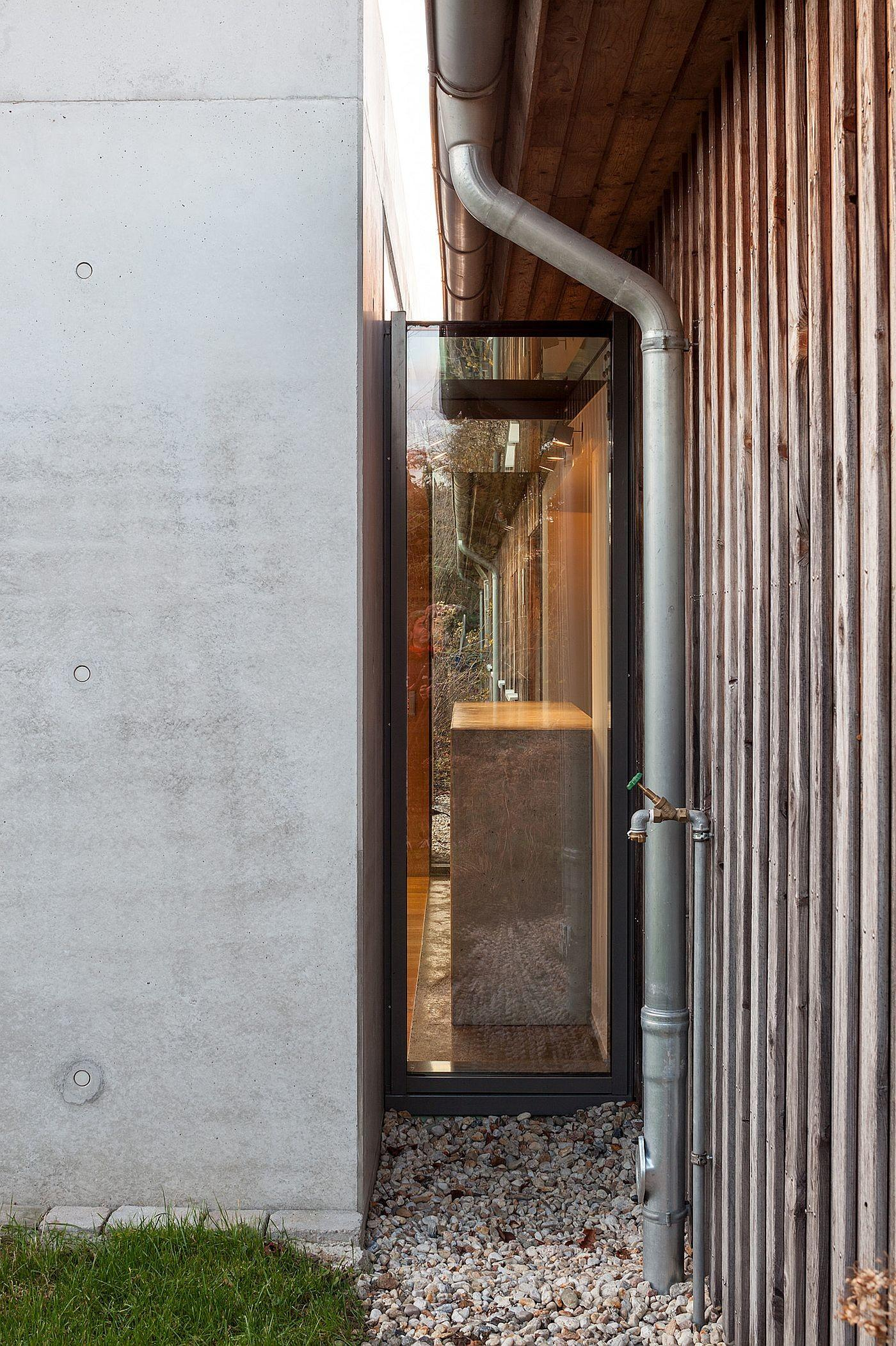 Glass Concrete Pavilion Extends Timber Paneled Home