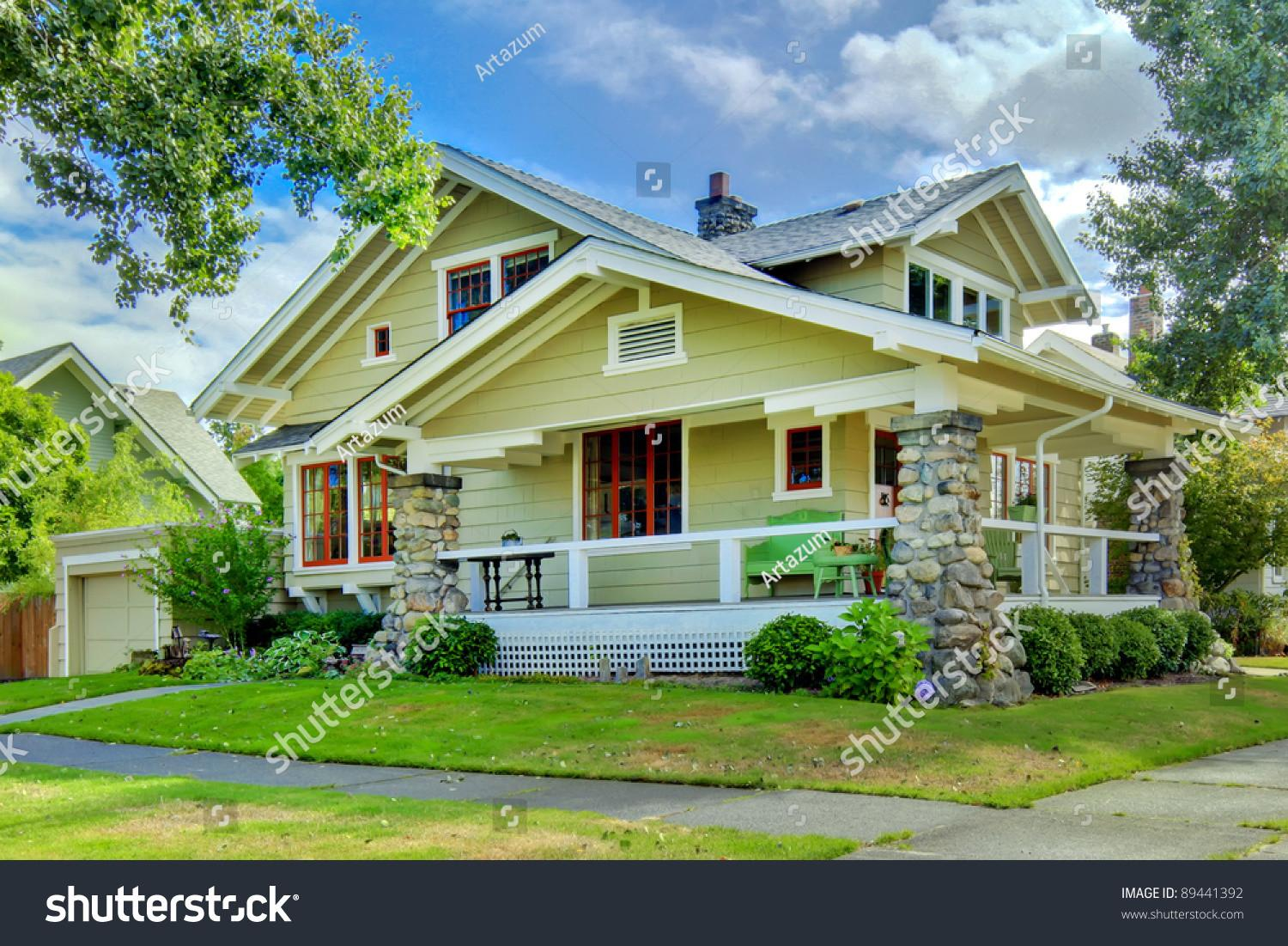 Green Old Craftsman Style Home Covered Stock