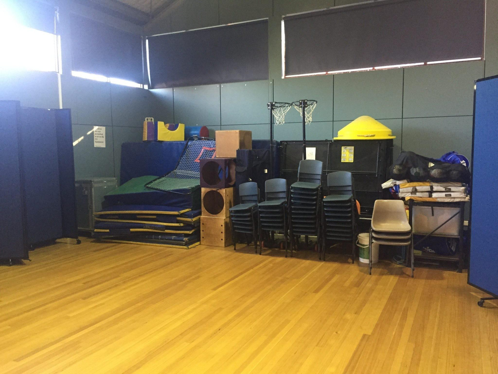 Hiding Unsightly Storage School Gym Using Portable