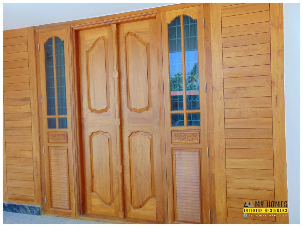 Kerala Style Double Door Design Blessed