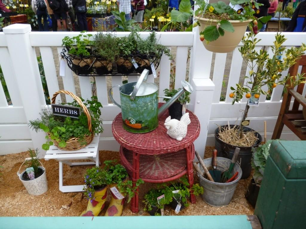 Mesmerizing Hanging Pot Installed Small Balcony Garden