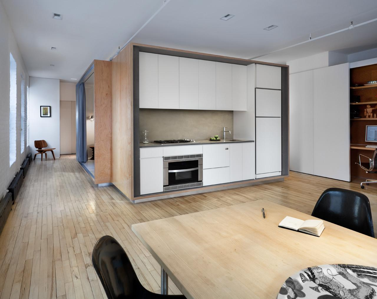 Modern Loft Removes Partitions Favor Plywood Volume