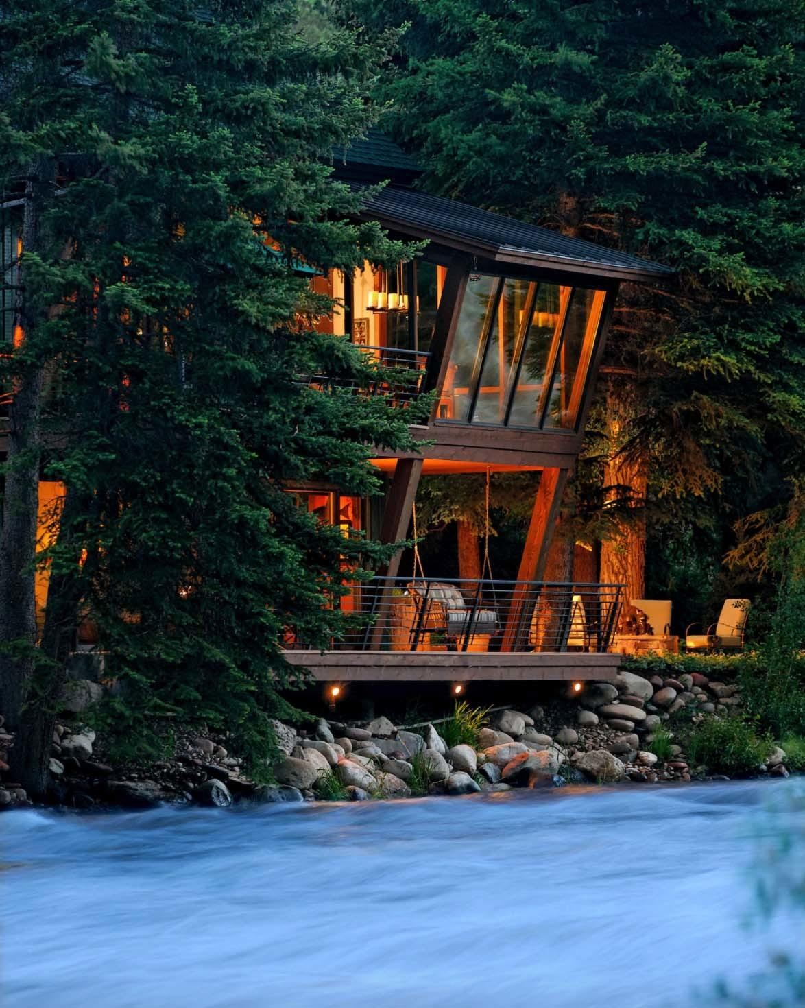 Modern Treehouse Suspended Over Roaring River Old