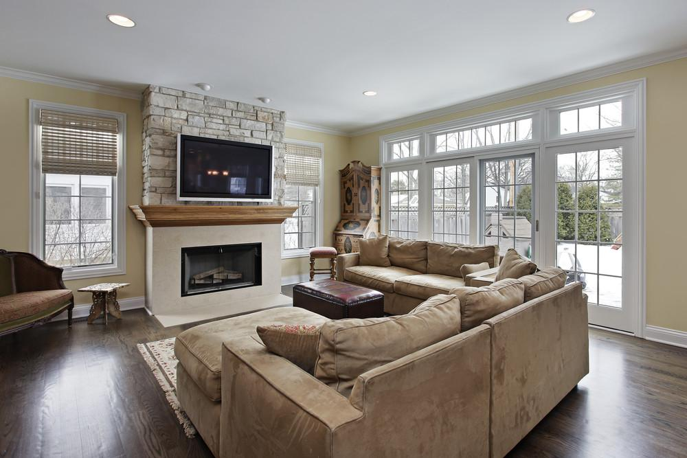 Red Rug Beige Couch Stone Fireplace Living Rooms