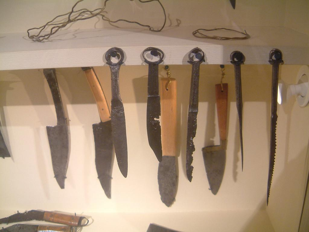 Roman Knives Cutting Tools Text Display