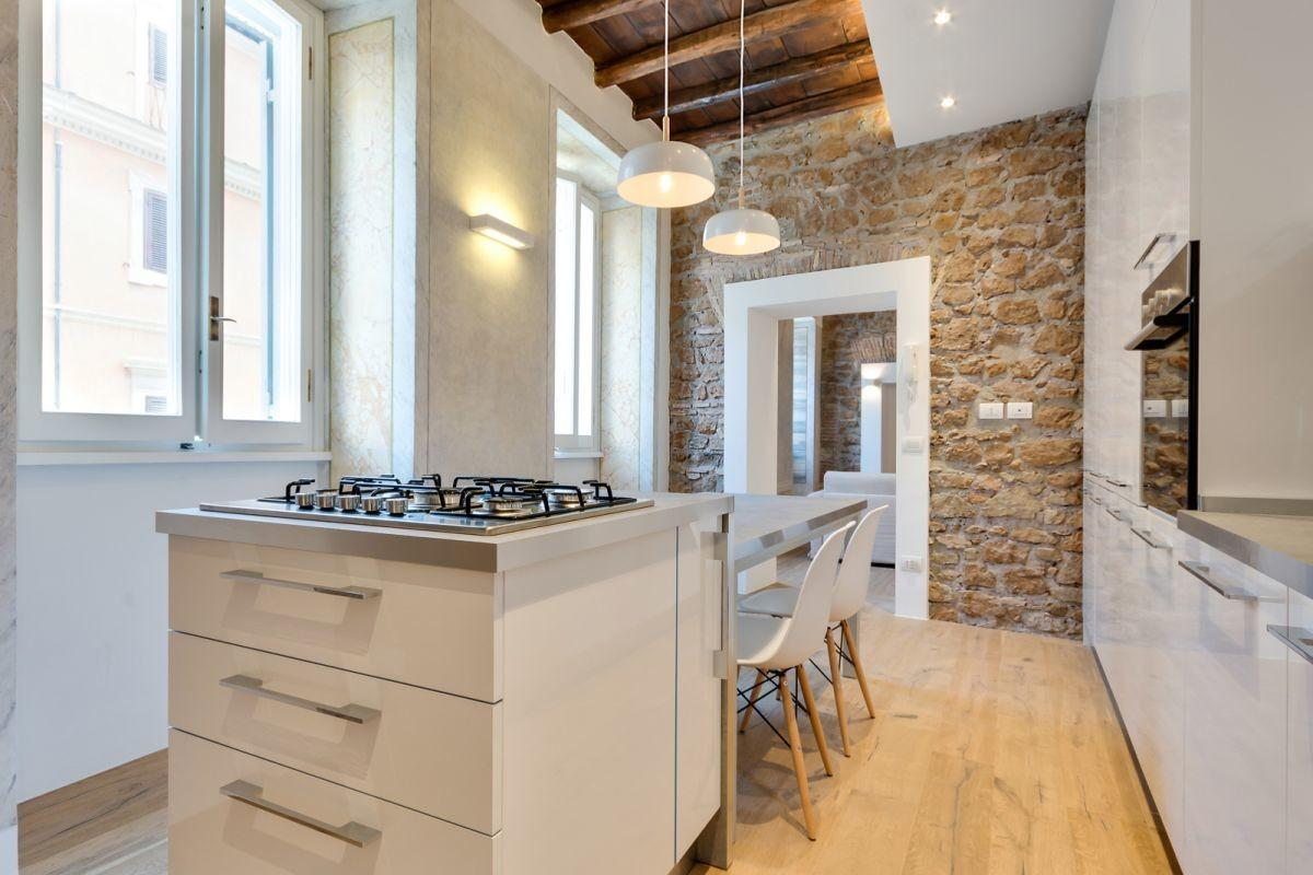 Rome Apartment Seamlessly Mixes Rustic Modern Features