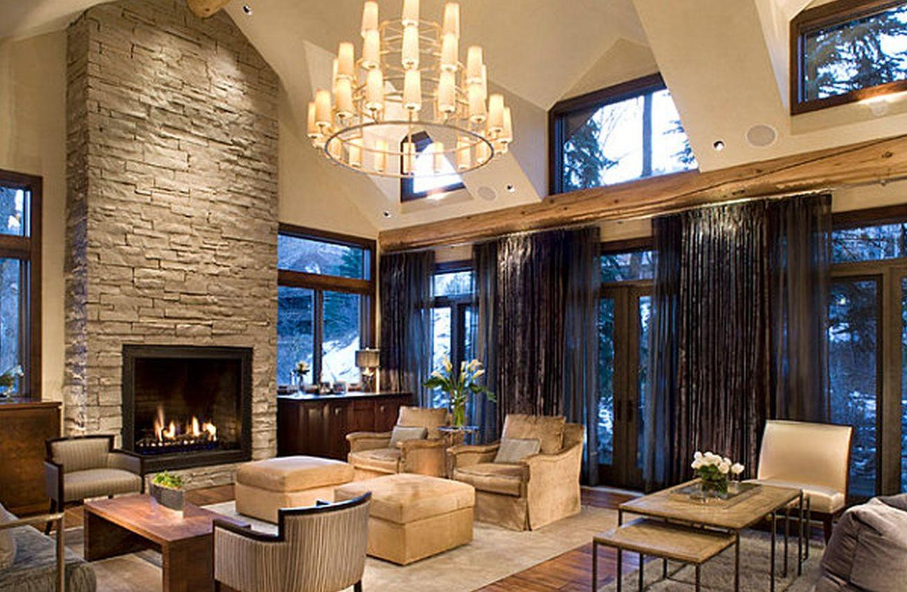 Rustic Dining Room Exposed Beam Stone Fireplace
