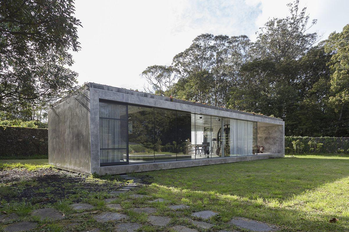Striking Concrete Glass Home Has Twist Curbed