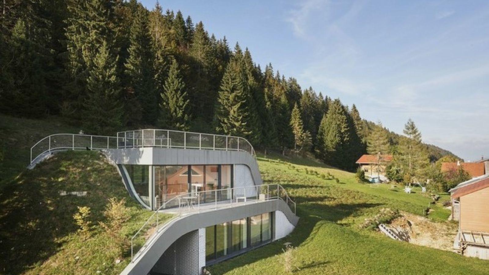 Swooping French Home Partially Built Into Hillside