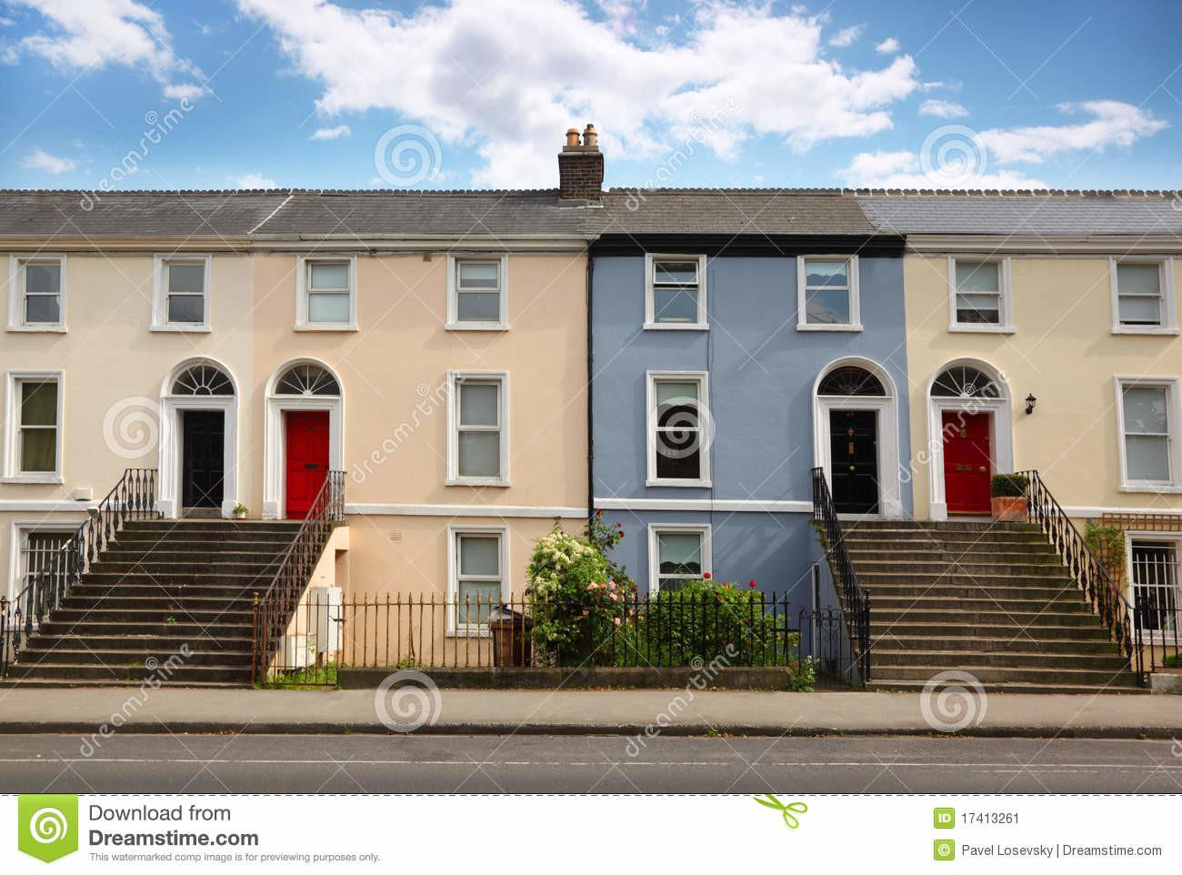 Three Story House Stands Beside Road Stock