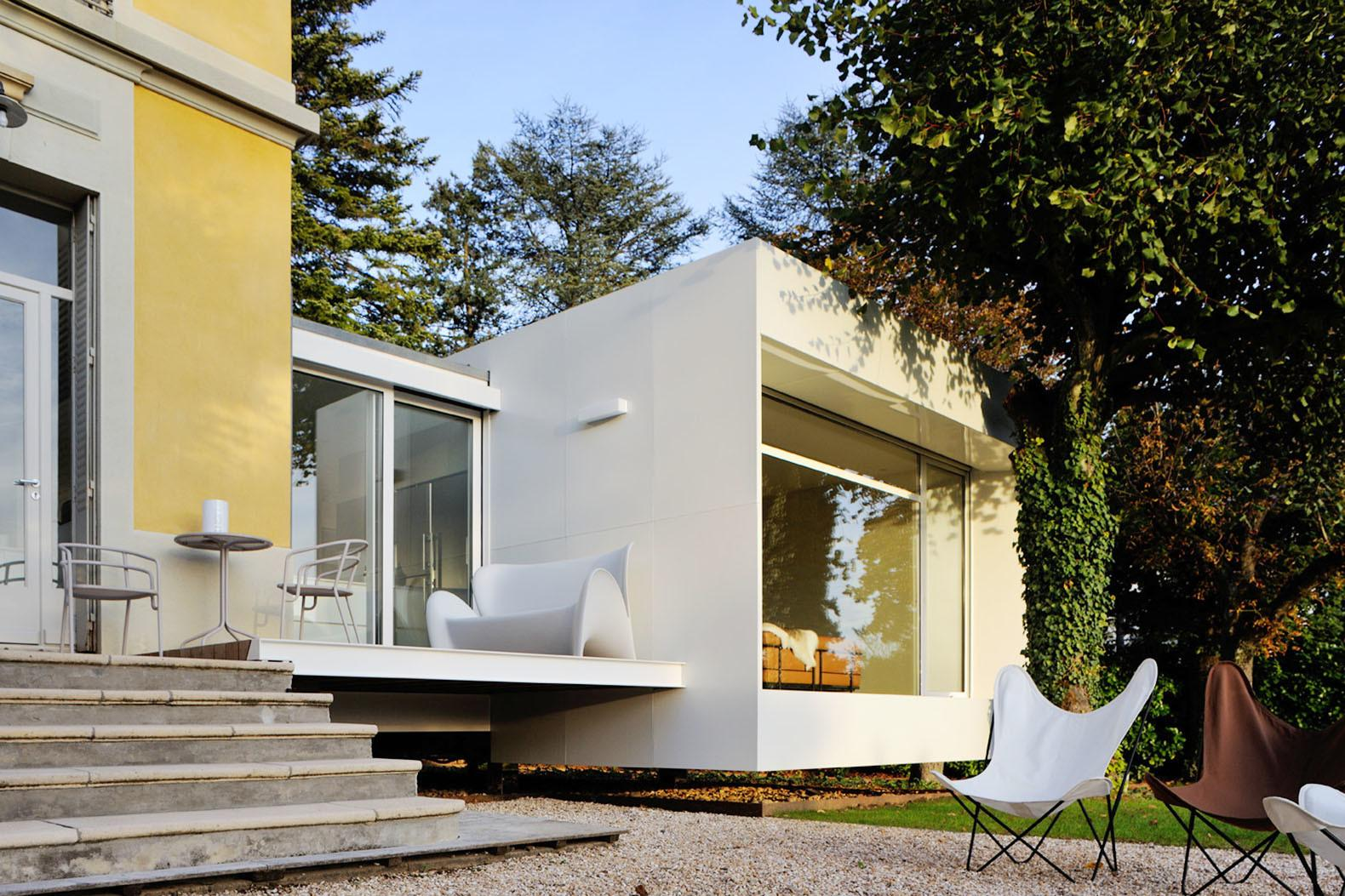Tiny Floating Cube Extends Charming 19th Century House
