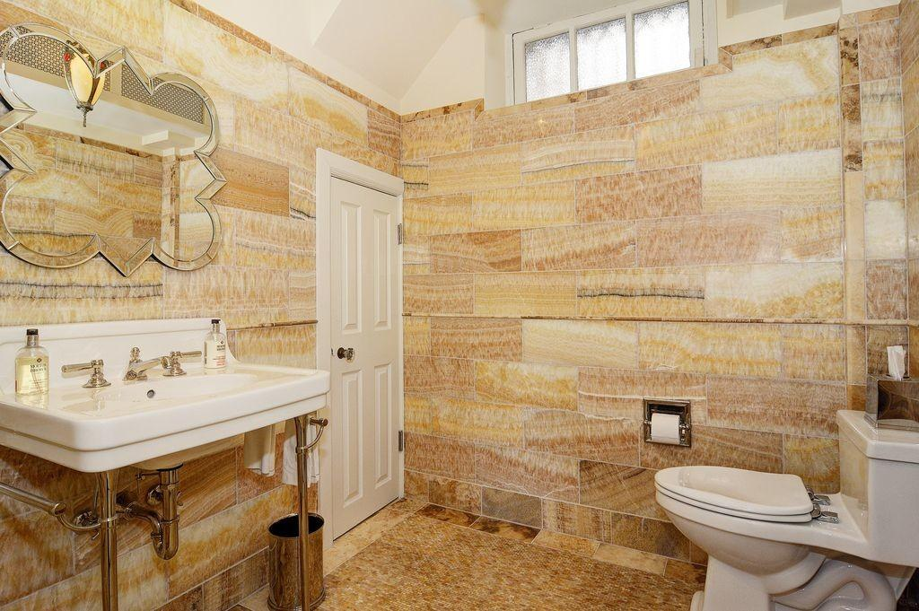 Traditional Powder Room High Ceiling Penny Tile