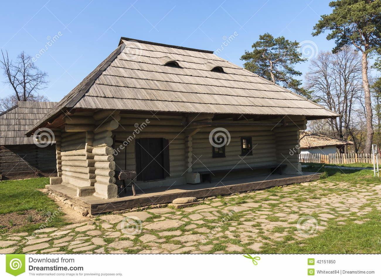 Traditional Romanian Wooden Rustic House Stock