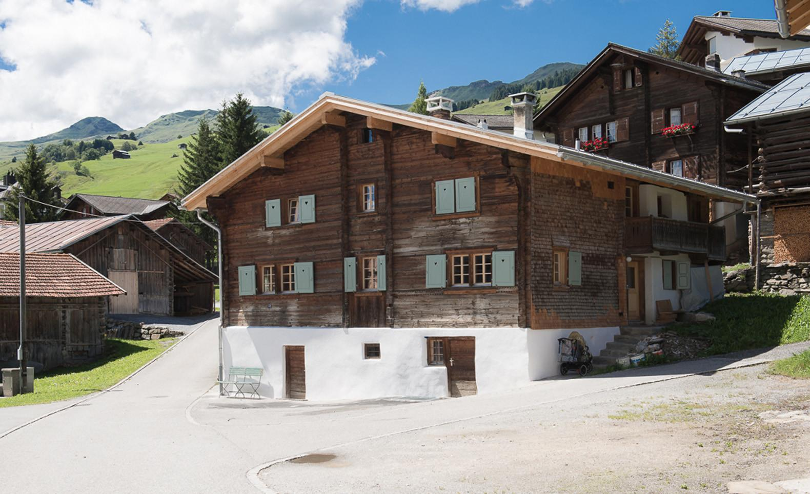 Traditional Swiss Ski Chalet Renovated Into Two Modern