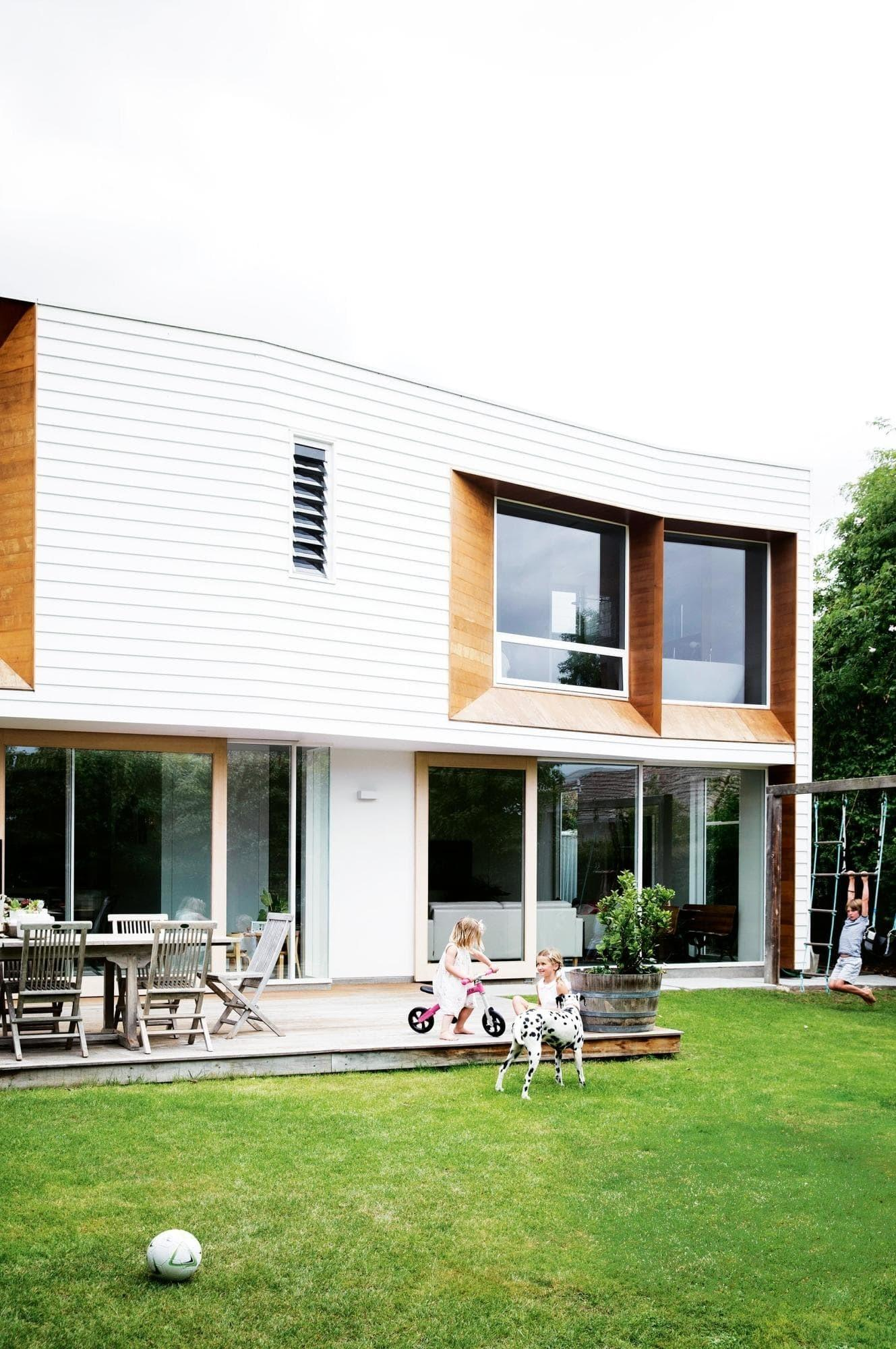 Weatherboard Extension Transforms 50s Brick House